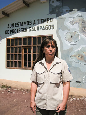 "Raquel Molina, the director of Galápagos National Park, stands in front of a mural at park headquarters that says, ""There is still time to protect the Galápagos."" ©Joshua Brockman 2007. All Rights Reserved."