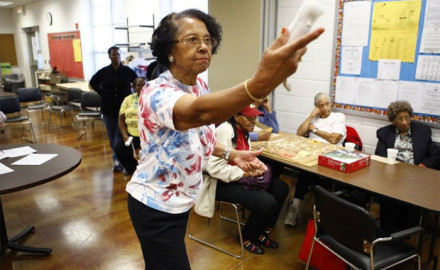 Willa Mae Graham, 81, competes in a Wii bowling game at the Langston-Brown Senior Center in Arlington, Va. The interactive video game has gained popularity among seniors, bringing them together for socializing and low-impact exercise.