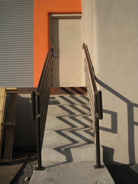 Shadows lead the way to an orange doorway at dusk in Santa Fe, New Mexico. ©Joshua Brockman 2012. All Rights Reserved.
