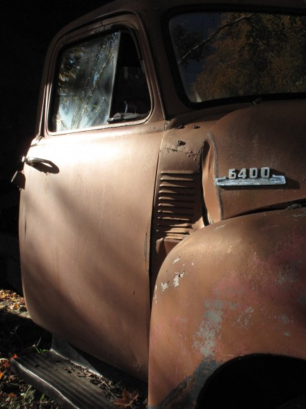 The cab of an old truck is illuminated by early morning sunlight inside an historic Vermont barn. ©Joshua Brockman 2010. All Rights Reserved.
