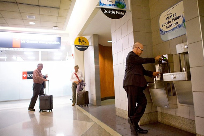 Dr. Stephen Klasko, chief executive of Thomas Jefferson University and Jefferson Health, who typically travels two or three times a week, refilling his water bottle at a station in Philadelphia International Airport. Credit Mark Makela for The New York Times.